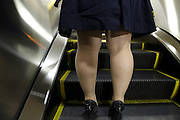 young obese woman on an escalator Tokyo Japan