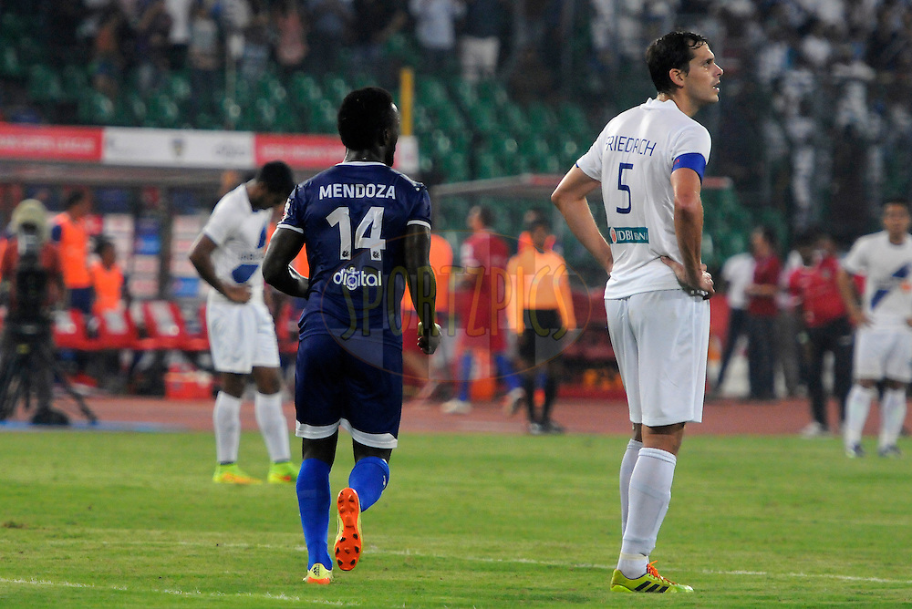 John Stiven Mendoza Valencia of Chennaiyin FC celebrates a goal as Manuel Friedrich of Mumbai City FC looks on during match 15 of the Hero Indian Super League between Chennaiyin FC and Mumbai City FC held at the Jawaharlal Nehru Stadium, Chennai, India on the 28th October 2014.<br /> <br /> Photo by:  Pal Pillai/ ISL/ SPORTZPICS