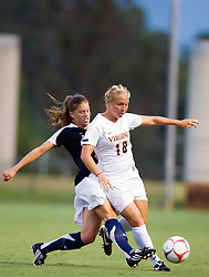Georgetown Hoyas midfielder Kelly D'Ambrisi (17) challenges Virginia Cavaliers defender Amanda Fancher (18).  The #6 Virginia Cavaliers played the Georgetown Hoyas to a 2-2 draw in a NCAA Women's Soccer pre-season exhibition game held at Klockner Stadium on the Grounds of the University of Virginia in Charlottesville, VA on August 18, 2008.
