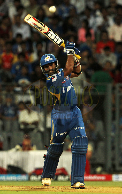 Mumbai Indian player Dinesh Karthik plays a shot during match 54 of the Indian Premier League ( IPL) 2012  between The Mumbai Indians and the Royal Challengers Banglore held at the Wankhede Stadium in Mumbai on the 9th May 2012..Photo by Vipin Pawar/IPL/SPORTZPICS.