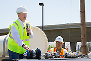 General Electric (GE) Global Product Marketing Leader Eric Quick demonstrates how new Pacific Gas and Electric Company (PG&E) in-line inspection tools called Smart Pigs move, inspect, and relay information to workers inside Bay Area gas pipelines.  Photo by Stan Olszewski/SOSKIphoto.