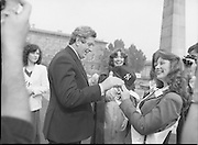 An Taoiseach Meets The Roses Of Tralee.  (N90)..1981..28.08.1981..08.28.1981..28th August 1981..An Taoiseach, Garret Fitzgerald, met with the contestants of The Rose Of Tralee Festival when they were invited to Government Buildings, Leinster House, Dublin...Image of An Taoiseach, Garret Fitzgerald, being presented with a New York baseball cap by New York Rose, Donna Maureen Kane. Dublin Rose, Catherine O'Connor (centre) sees the funny side.