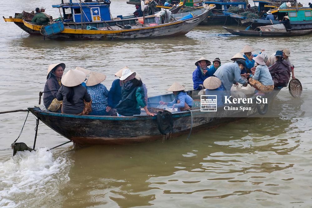Boats on the Thu Bon River.
