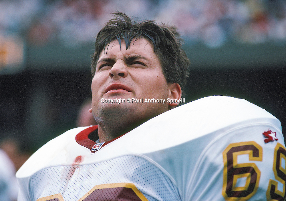 Washington Redskins guard Mark Schlereth looks on from the sideline during the NFL football game against the Cincinnati Bengals on Sunday, Sept. 22, 1991 in Cincinnati. The Redskins won the game 34-27. (©Paul Anthony Spinelli)