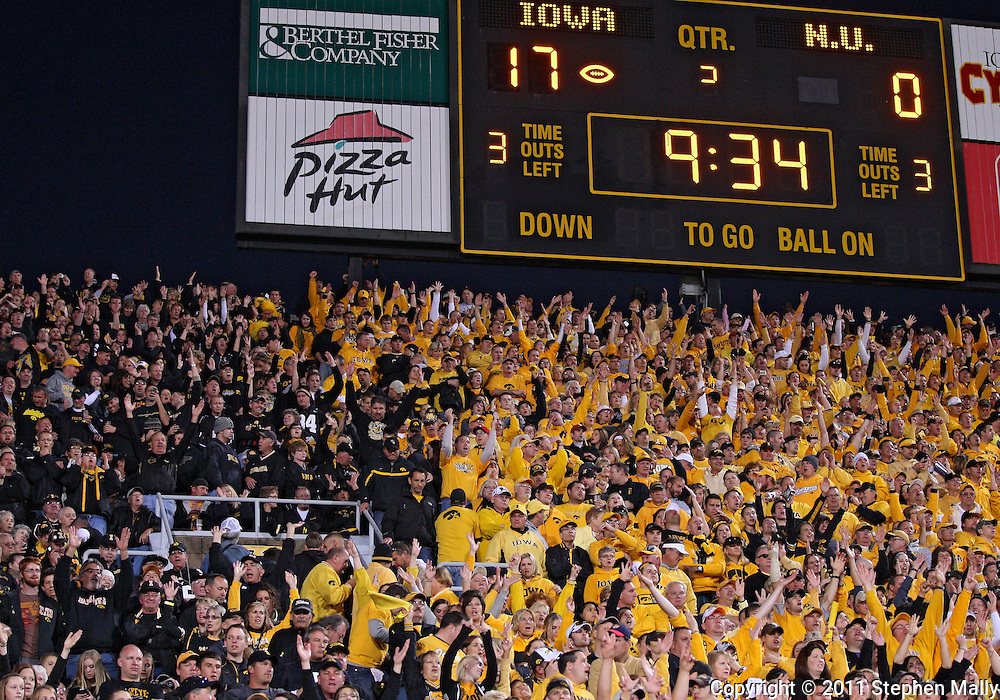 October 15, 2011: Iowa fans cheer after a score during the first half of the NCAA football game between the Northwestern Wildcats and the Iowa Hawkeyes at Kinnick Stadium in Iowa City, Iowa on Saturday, October 15, 2011. Iowa defeated Northwestern 41-31.