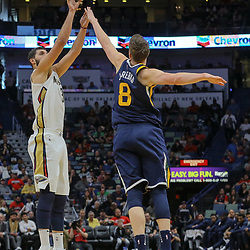 Mar 11, 2018; New Orleans, LA, USA; New Orleans Pelicans forward Nikola Mirotic (3) shoots over Utah Jazz forward Jonas Jerebko (8) during the first half at the Smoothie King Center. Mandatory Credit: Derick E. Hingle-USA TODAY Sports