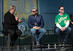 A's broadcaster Glenn Kuiper, left, interviews Executive Vice President of Baseball Operations Billy Beane and manager Bob Melvin during Oakland Athletics FanFest at Jack London Square on Saturday, Jan. 27, 2018 in Oakland, Calif. (D. Ross Cameron/SF Chronicle)