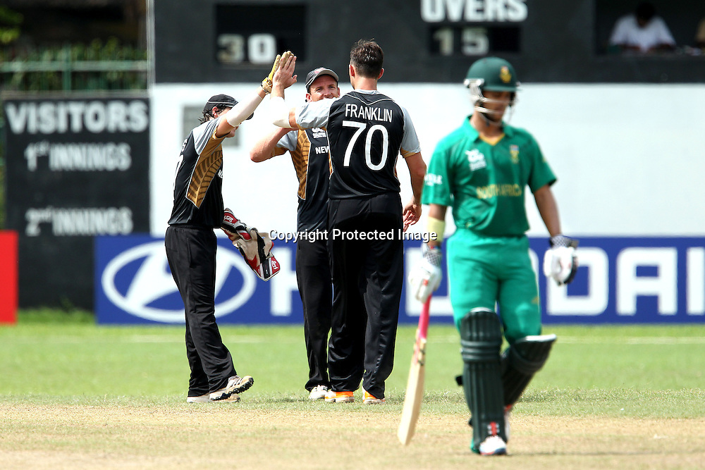James Franklin celebrates the wicket of JP Duminy during the ICC Twenty 20 World Cup warm up match between New Zealand and South Africa held at the Colts Cricket Club in Colombo, Sri Lanka on the 17th September 2012<br /> <br /> Photo by Ron Gaunt/SPORTZPICS/PHOTOSPORT