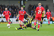 Burton Albion midfielder Hamza Choudhury challenges Oldham midfielder Carl Winchester during the Sky Bet League 1 match between Burton Albion and Oldham Athletic at the Pirelli Stadium, Burton upon Trent, England on 26 March 2016. Photo by Aaron Lupton.