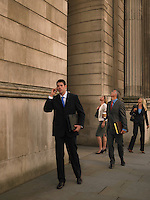 Business people outside monumental building