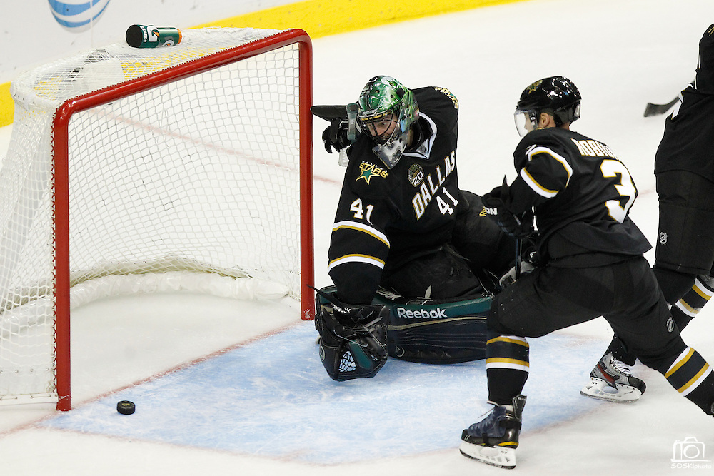 Dallas Stars goalie Cristopher Nilstorp (41) watches as the puck skims just outside the goal post during a shot attempt by the St. Louis Blues at the American Airlines Center in Dallas, Texas, on January 26, 2013.  (Stan Olszewski/The Dallas Morning News)