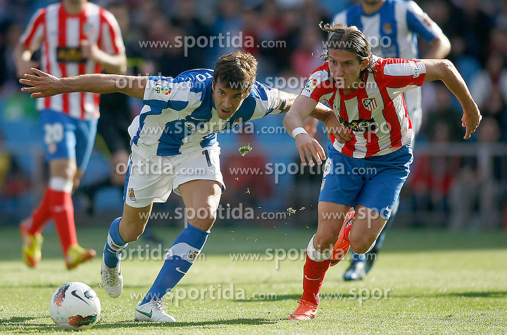 02.05.2012, Vicente Calderon Stadion, Madrid, ESP, Primera Division, Atletico Madrid vs Real Sociedad, Ersatztermin, im Bild Atletico de Madrid's Filipe Luis (r) and Real Sociedad's Xabi Prieto // during the football match of spanish 'primera divison' league, alternate date, between Atletico Madrid and Real Sociedad at Vicente Calderon stadium, Madrid, Spain on 2012/05/02. EXPA Pictures © 2012, PhotoCredit: EXPA/ Alterphotos/ Acero..***** ATTENTION - OUT OF ESP and SUI *****