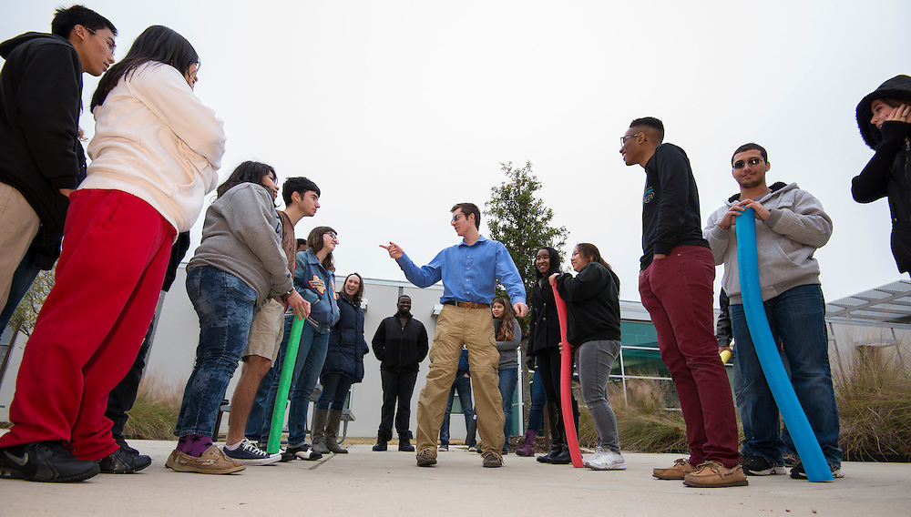 Students conduct physiology role-playing exercises in the courtyard of Carnegie Vanguard High School, February 3, 2014.