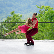 Sinead Kerr and Matej Silecky of Ice Dance International perform on the outdoor stage at Jacobs Pillow, July 2019