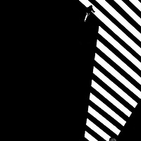 The contrasting top view of a square with markings and zebra stripes.
