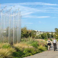 A couple walk in Tongva Park on Wednesday, July 30, 2014.