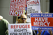 Members of the Open Doors Charity stage a protest outside the Chinese Embassy in london, UK, to call for North Korean Refugees to be given more freedoms and rights.