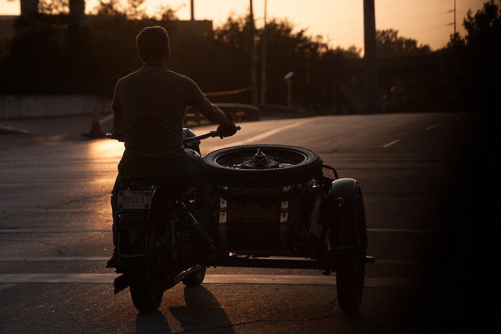 Motorcycle rider with empty sidecar.