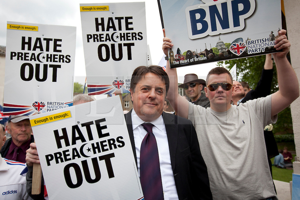 © Licensed to London News Pictures. 01/06/2013. London, UK. British National Party (BNP) leader, Nick Griffin is seen with supporters at a protest in Central London today (01/06/2013). The protest, held in response to the killing of Drummer Lee Rigby, was surrounded by a protective police cordon after members of Unite Against Fascism broke through police lines in an attempt to get to the BNP protesters. Photo credit: Matt Cetti-Roberts/LNP