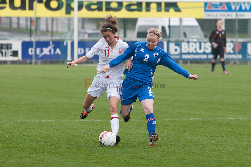 21120413 - IEPER, BELGIUM : England's  Rosella Ayane (11)   and Iceland's  Berglind Ágústsdóttir (2) fight for the ball  during the Second qualifying round of U17 Women Championship between England and Iceland on Friday April 13th, 2012 in Ieper, Belgium.