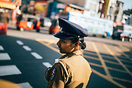 A traffic cop directs cars in downtown Colombo, Sri Lanka, Asia