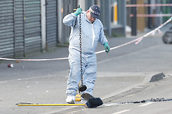 © Licensed to London News Pictures. 20/01/2020. London, UK. Police lower a magnet into a drain as they search for weapons in the area around a murder scene in Seven Kings in east London. An investigation has been  launched into the deaths of three men all of whom had suffered apparent stab injuries. Photo credit: Peter Macdiarmid/LNP