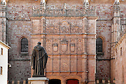 """View from behind of statue of Fray Luis de Leon, Patio de Escuelas, Salamanca University, Salamanca, Spain, pictured on December 18, 2010 in the afternoon. Fray Luis de Leon (1527/8-91) was Thomas Aquinas Professor of theology at Salamanca from 1561. The statue, by Nicasio Sevilla, was erected in 1869. Salamanca, an important Spanish University city, is known as La Ciudad Dorada (""""The golden city"""") because of the unique golden colour of its Renaissance sandstone buildings. Founded in 1218 its University is still one of the most important in Spain. Around it the Old Town is a UNESCO World Heritage Site. Picture by Manuel Cohen"""