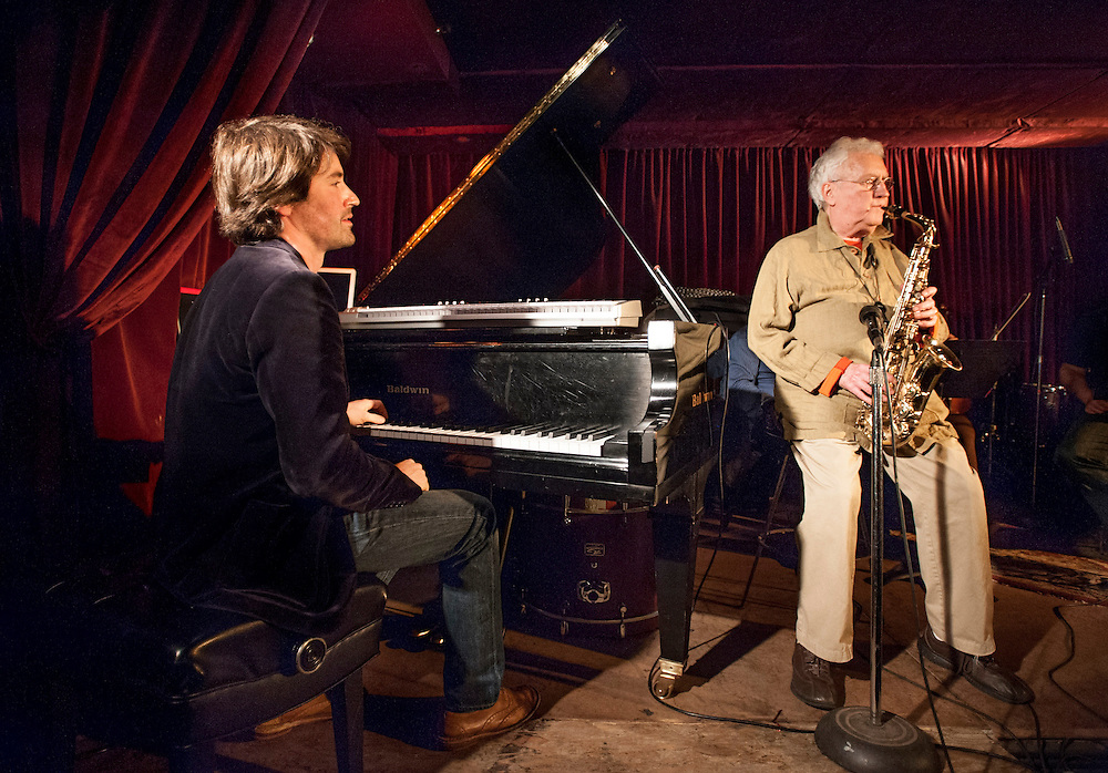 Dan Tepfer talks with Lee Konitz at the Zinc Bar during the 2013 Winter Jazz Fest between sets of the duo's performance with string quartet, New York City, Friday January 11, 2013.