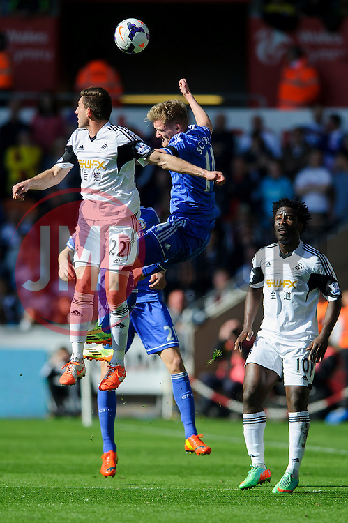 Angel Rangel (ESP) of Swansea and Andre Schurrle (GER) of Chelsea compete in the air - Photo mandatory by-line: Rogan Thomson/JMP - 07966 386802 - 13/04/2014 - SPORT - FOOTBALL - Liberty Stadium, Swansea -  Swansea City v Chelsea FC - Barclays Premier League.