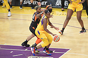Los Angeles Sparks guard Chelsea Gray (12) spins away from Connecticut Sun guard Courtney Williams (10) during a WNBA basketball game, Friday, May 31, 2019, in Los Angeles.The Sparks defeated the Sun 77-70.  (Dylan Stewart/Image of Sport)