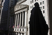 George Washington statue and classical pillars of the New York Stock Exchange (NYSE) on Wall Street, Lower Manhattan,.