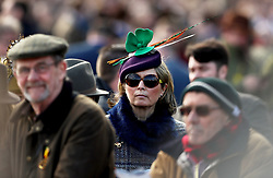 A female racegoer in the crowd wears an Irish themed fascinator during St Patrick's Thursday of the 2018 Cheltenham Festival at Cheltenham Racecourse.