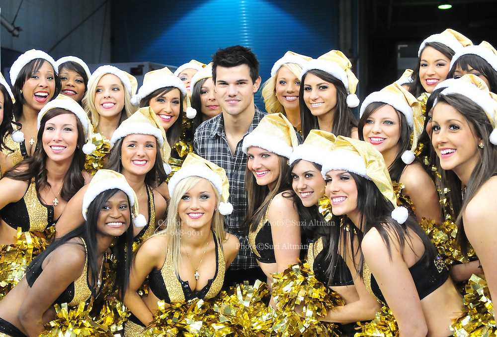 "Twilight ACTOR TAYLOR LAUTNER gets wrapped up by the New Orleans Saints cheerleaders the "" Saintsations""just before kickoff against the St. Louis Rams Subnday at the Super Dome in NEw Orkeans.hangs out on the Saints sidelines and poses with Saints owner Rita Benson Leblanc  prior to the kick off against the St. Louis Ram.The New Orleans Saints play the St. Louis rams in New Orleans at the Super Dome Sunday Dec. 12,2010. Saints went on to win 31-13. Photo©SuziAltman. New Orleans, Louisiana, U.S. - Twilight Actor TAYLOR LAUTNER hangs out on the Saints sidelines prior to the kick off against the St. Louis Ram.The New Orleans Saints play the St. Louis rams in New Orleans at the Super Dome Sunday Dec. 12,2010. Saints went on to win 31-13..(Credit Image: © Suzi Singer and actress MILEY CYRUS poses for a fan's camera phone with New Orleans police officers on the sidelines prior to The New Orleans Saints' kickoff against the St. Louis Rams at the Superdome. Cyrus is currently filming ''So Undercover'' in New Orleans.Photo©Suzi Altman Twilight series ACTOR TAYLOR LAUTNER  wears a headset and listens as the plays are being called on the New Orleans Sainst sidelines during the game against the St. Louis Rams. LAUTNER and poses with Saints owner Rita Benson Leblanc  prior to the kick off against the St. Louis Ram.The New Orleans Saints play the St. Louis rams in New Orleans at the Super Dome Sunday Dec. 12,2010. Saints won 31-13.Photo©SuziAltman. New Orleans, Louisiana, U.S. - Twilight Actor TAYLOR LAUTNER hangs out on the Saints sidelines prior to the kick off against the St. Louis Ram.The New Orleans Saints play the St. Louis rams in New Orleans at the Super Dome Sunday Dec. 12,2010. Saints went on to win 31-13.Photo©Suzi Altman"