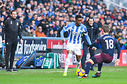 Jan Siewert of Huddersfield Town (Manager) watches on as Adama Diakhaby of Huddersfield Town (11) takes on Nacho Monreal of Arsenal (18) during the Premier League match between Huddersfield Town and Arsenal at the John Smiths Stadium, Huddersfield, England on 9 February 2019.