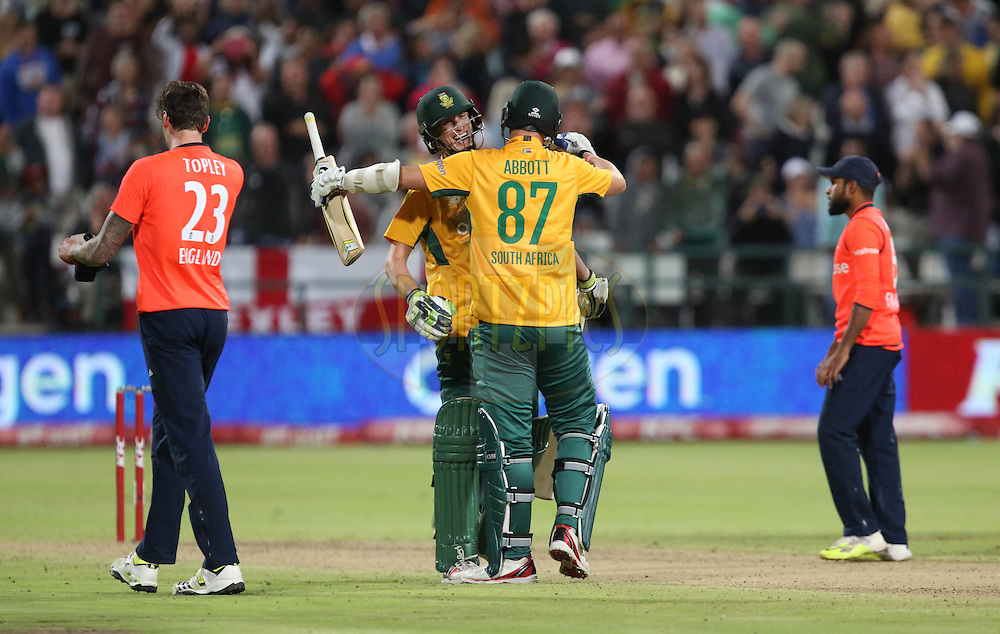 Kyle Abbott hugs Chris Morris during the First KFC T20 Match between South Africa and England played at Newlands Stadium, Cape Town, South Africa on February 19th 2016