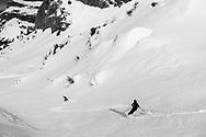 Ski tourers ar skiing down from mount Glatten, Muotathal, Schwyz, Switzelrand