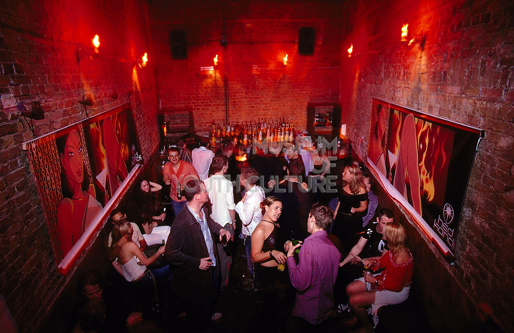 The bar and crowd drinking at Club 144 London May 2002
