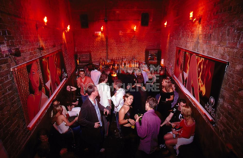 The bar and crowd drinking at Club 144 London May 2002