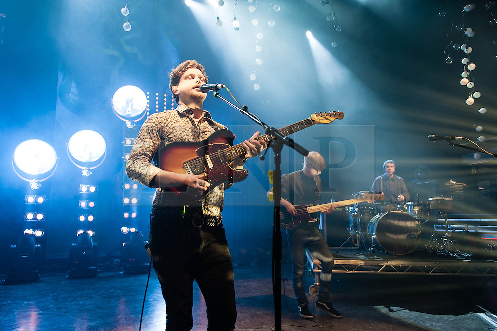 © Licensed to London News Pictures. 18/01/2013. London, UK.   Joe Newman  (left), Gwil Sainsbury (middle), and Thom Green (right) of  Alt-J (?) performing live at O2 Shepherds Bush Empire. ? (pronounced Alt-J) is a British indie rock quartet, formed in 2007,comprising of Gwil Sainsbury (guitarist/bassist), Joe Newman (guitar/vocals), Gus Unger-Hamilton (keyboards) and Thom Green (drums).  Their debut album An Awesome Wave was released in May 2012 in Europe and September 2012 in the United States and won the 2012 British Mercury Prize.  ?'s name is pronounced ?Alt-J?, which is the keyboard shortcut used on Apple OS X to insert the Greek letter Delta.   Photo credit : Richard Isaac/LNP