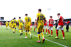 Bristol Rovers and Fleetwood Town players walk out - Mandatory by-line: Matt McNulty/JMP - 27/04/2019 - FOOTBALL - Highbury Stadium - Fleetwood, England - Fleetwood Town v Bristol Rovers - Sky Bet League One