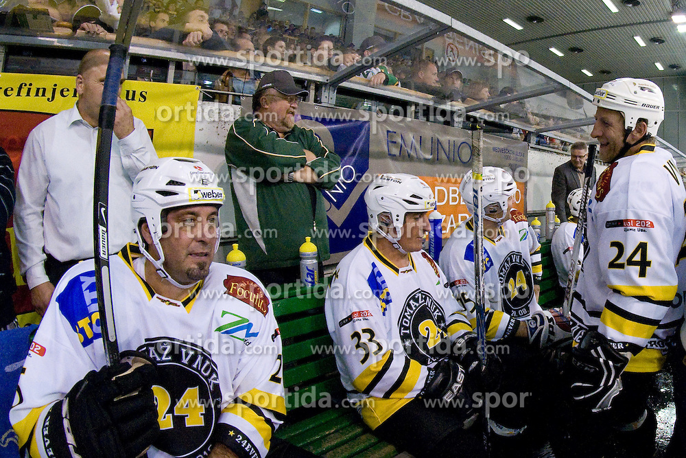 Toni Tisler, Ignac Filipovic and Tomaz Vnuk on a bench in Tomaz Vnuk's exhibition game between team HDD Tilia Olimpija and team 24 Ever on August 28, in Ljubljana, Slovenia. (Photo by Matic Klansek Velej / Sportida)
