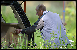 HM The Duke of Edinburgh gets what looks like his lunch bag out of his car as he  judging the International  carriage driving at Windsor Horse Show. Windsor, United Kingdom. Saturday, 17th May 2014. Picture by Andrew Parsons / i-Images