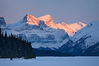 Winter sunset over the Queen Elizabeth Range and Maligne Lake, Jasper National Park Alberta Canada