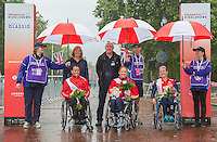 Sandra Graf (SUI) second place winner, Karen Darke (GBR) the first placed rider and Jennifer Browning (GBR) the third placed rider with presenters Leon Daniels Managing Director of Surface Transport at Transport for London and Cathy Lewis Executive Director of Prudential UK and Europe at the medal ceremony for the Womens Handcycle Classic at Prudential RideLondon, the world's greatest festival of cycling, involving 70,000+ cyclists – from Olympic champions to a free family fun ride - riding in five events over closed roads in London and Surrey over the weekend of 9th and 10th August. <br /> <br /> Photo: Neil Turner for Prudential Ride London<br /> <br /> Sunday 10th August 2014<br /> <br /> See www.PrudentialRideLondon.co.uk for more.<br /> <br /> For further information: Penny Dain 07799 170433<br /> pennyd@ridelondon.co.uk