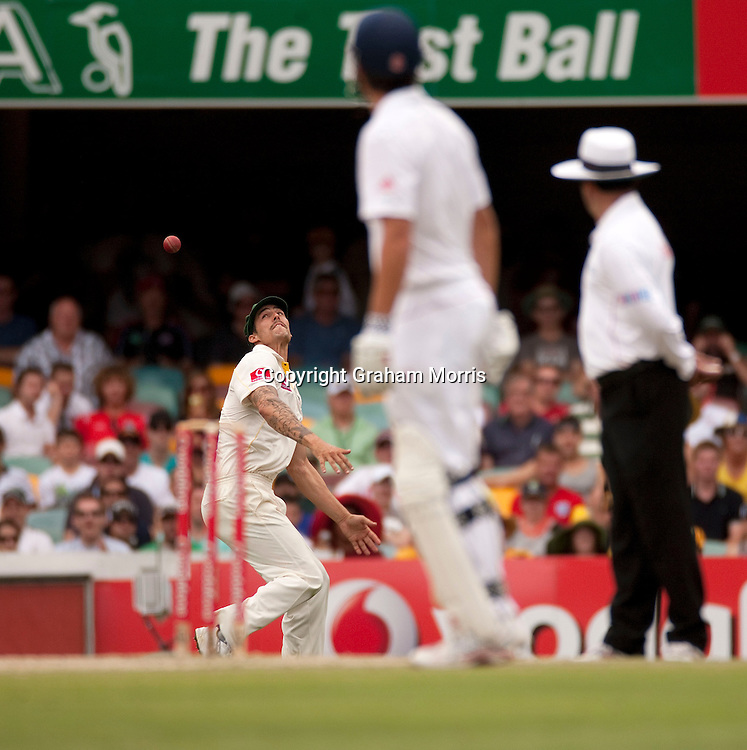 All eyes on Mitchell Johnson as he drops Andrew Strauss during the first Ashes Test Match between Australia and England at the Gabba, Brisbane. Photo: Graham Morris (Tel: +44(0)20 8969 4192 Email: sales@cricketpix.com) 28/11/10