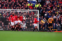Danny Murphy (13) Liverpool bends the ball around the United wall to score the only goal of the game,which resulted in United's first home defeat in two years. Manchester United v Liverpool. FA Premiership, 17/12/2000. Credit: Colorsport / Andrew Cowie.
