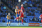 Keith Keane wins a challenge during the EFL Sky Bet League 1 match between Shrewsbury Town and Rochdale at Greenhous Meadow, Shrewsbury, England on 8 April 2017. Photo by Daniel Youngs.