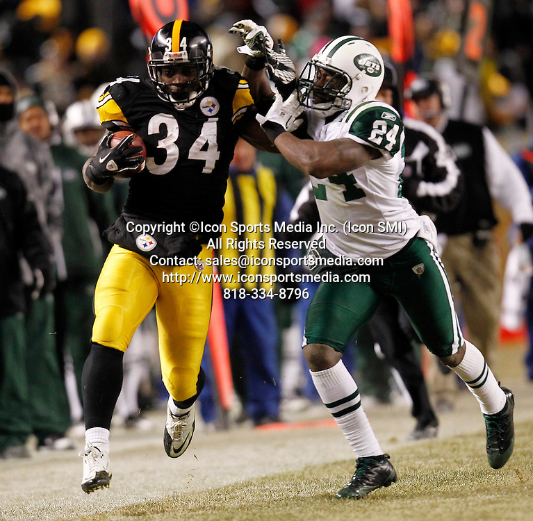 Pittsburgh Steelers running back Rashard Mendenhall (34) fends off New York Jets cornerback Darrelle Revis (24) in the first half of the AFC Championship game at Heinz Field on January 23, 2011 in Pittsburgh, PA..