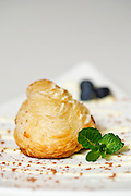A puff pastry garnished with mint and blueberries at Meridienne Dessert Salon and Cafe in Rogers, Arkansas.