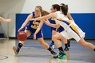 Lamoille's Katelin Collins (15) battles for the loose ball with Milton's Madison Chalmers (52) during the girls basketball game between Lamoille and Milton at Milton High School on Friday night December 18, 2015 in Milton, (BRIAN JENKINS/for the FREE PRESS)